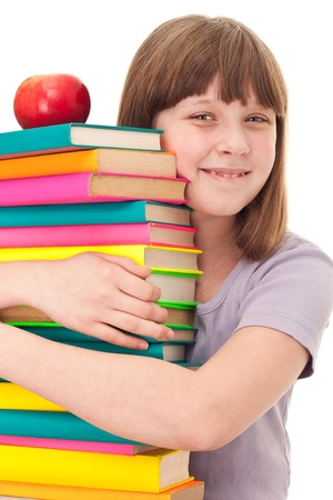young girl hugging books, love for books, isolated on background photo