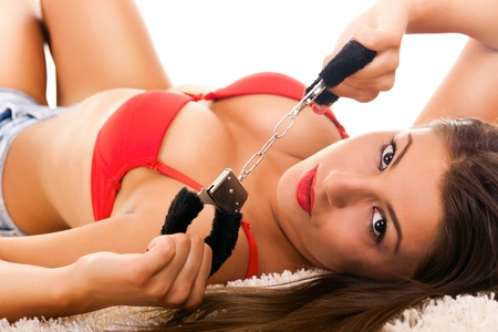 Hot naked brunette with handcuffs Stock Photo - 9319812