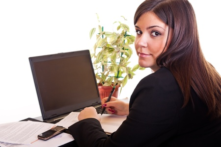 successes: business woman sitting in office and working with document Archivio Fotografico