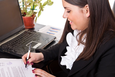 successes: business woman working with documents in the office  Archivio Fotografico