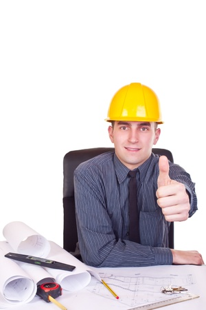 successful architect man sitting on desk and giving a thumb up photo