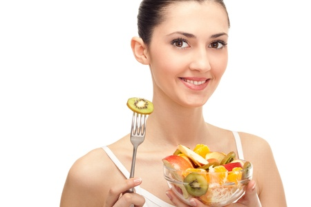 healthy lifestyle, woman holding fruit salad bowl on white background photo