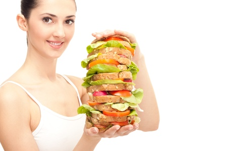 girl eating healthy sandwich isolated on white background photo