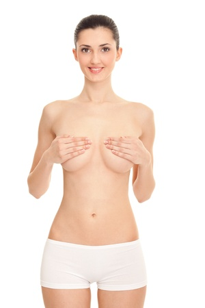 naked young woman covering her breast with hands against white background Stock Photo - 9394362