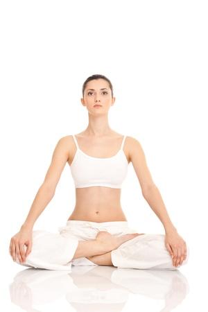 thai yoga: woman meditating in lotus position on floor on white background Stock Photo