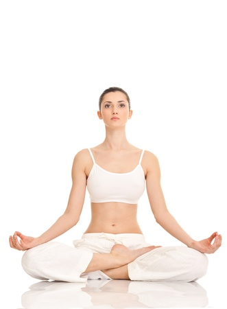 lotus pose: young woman practicing yoga in the lotus position, isolated on white Stock Photo