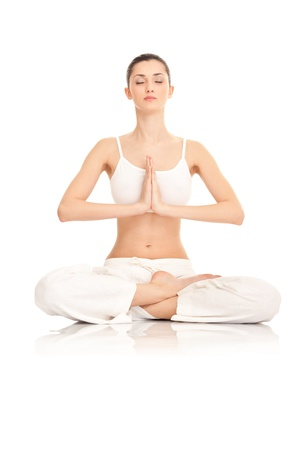 meditating woman: young  woman doing yoga  on white background