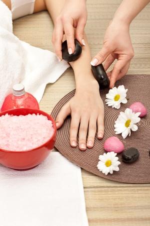hand massage at the spa salon photo