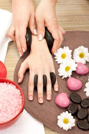 beauty therapist: beauty therapist hands massaging hands or manicure Stock Photo
