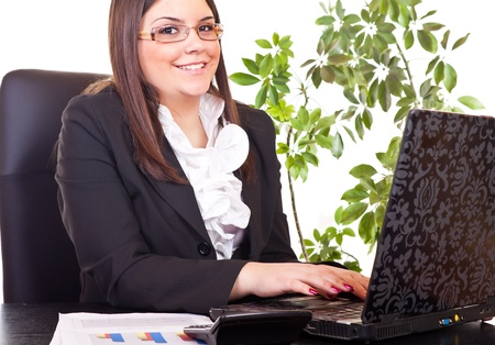 smiling businesswoman typing on computer in office  Stock Photo - 9394433