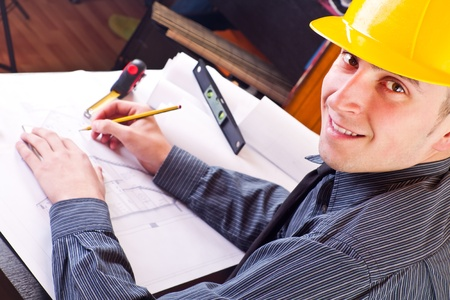 happy architect working on blueprint of house, close up Stock Photo - 9394457