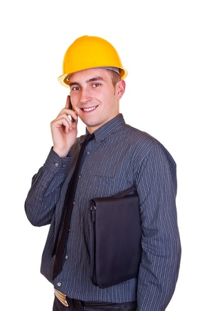 businessman wearing a hardhat on phone against a white background photo