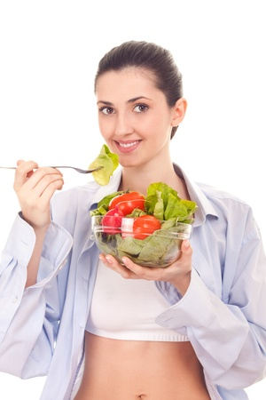woman with vegetables salad,  isolated on white photo