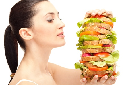 very hungry woman looking huge sandwich, isolated on background photo