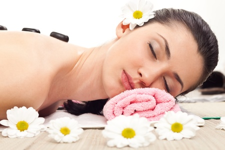 woman enjoying  in spa therapy with stone Stock Photo