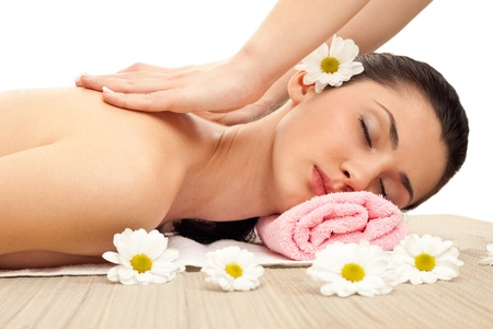 young woman receiving massage on back and neck Stock Photo