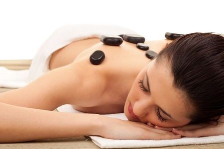 young woman getting a stone massage at spa salon Stock Photo - 9438389