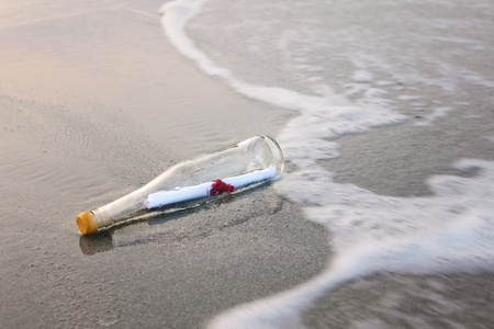 message bottle: love message in glass bottle on the beach