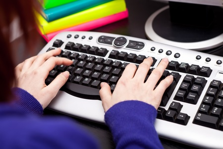students hands typing on keyboard photo