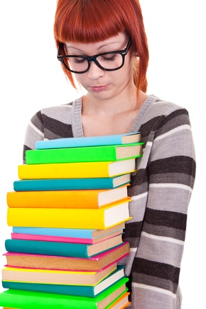 sad young girl with stack color books, isolated on white background Stock Photo - 9517414