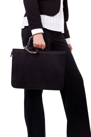 females hand with handcuff and a suitcase, isolated on white photo