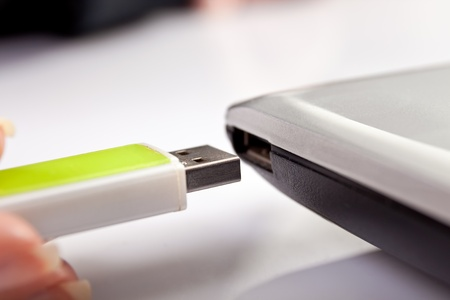 usb flash memory: laptop with a modem usb on desk Stock Photo