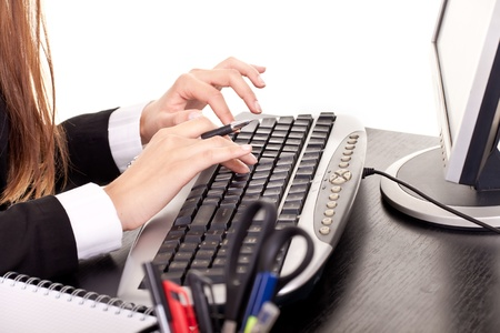 woman's hands typing in office, secretary typing Stock Photo - 9517241