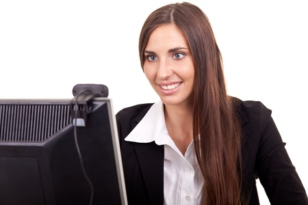 camera phone: young businesswoman sitting behind computer, online conference