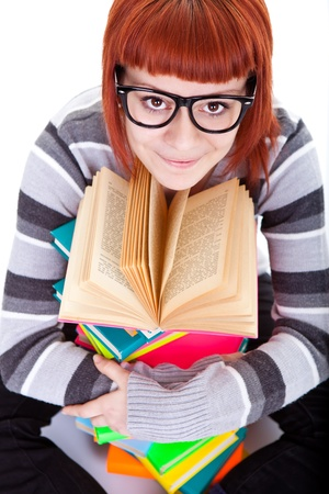 teenager girl smiling and reading book, close up photo