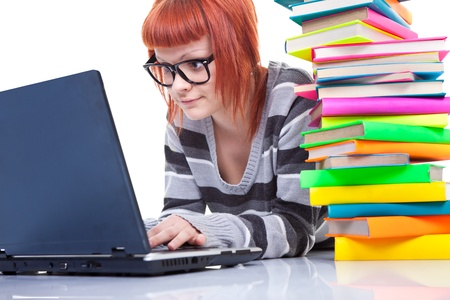 teenager girl with laptop and pile of color books, isolated on white Stock Photo - 9569416