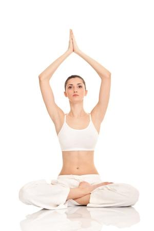 thai yoga: beautiful young woman doing yoga exercise, isolated on background