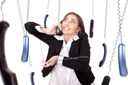 warped: clumsy young secretary with phone, answering a lot of calls at the same time,  isolated on white Stock Photo