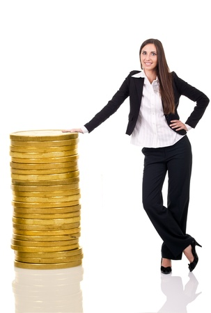 heap up: business woman standing with stack coins, isolated over a white background