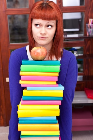 girl with stack color book, thinking about learning Stock Photo - 9617013