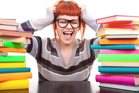 crazy schoolgirl screaming, holding hands up, between, stack of book, isolated on white photo