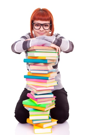student with pile of books, concept back to school, isolated on white photo