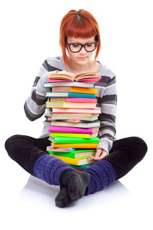 young girl with color pile of books reading photo