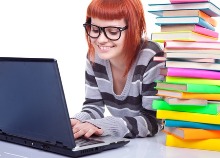 smiling girl with stack color book and laptop, isolated on white background, Stock Photo - 9617108