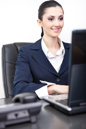 smiling business woman in  her chancellery working Stock Photo - 9617101