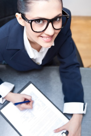 pretty secretary taking notes at office desk, top view Stock Photo - 9617086
