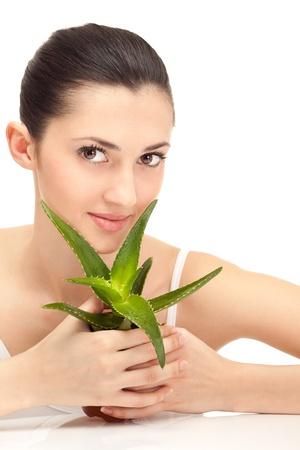aloe vera background: lovely woman with aloe vera, isolated on background