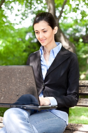 overworked businesswoman working on break in green park Stock Photo - 9617115