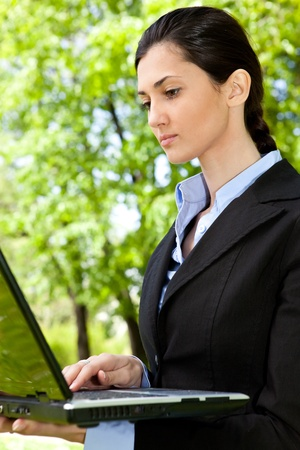 businesswoman working on laptop in nature Stock Photo - 9617135