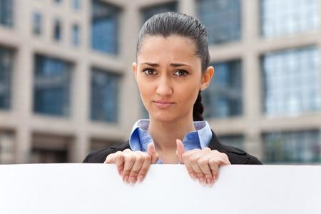 sad,  young businesswoman need job, hire me please  photo