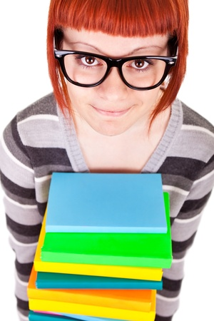school girl with stack color books and glasses, isolated on white background Stock Photo - 9653380
