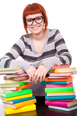 smiling teenager girl with stack of color books, isolated on white photo