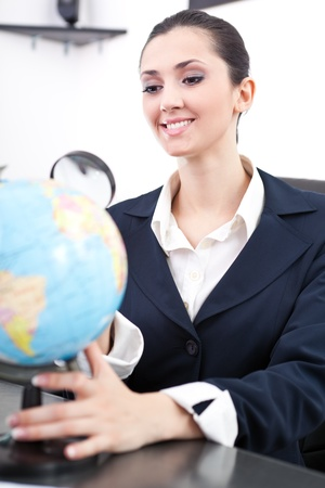 young businesswoman searching new job,  looking globe Stock Photo - 9653381