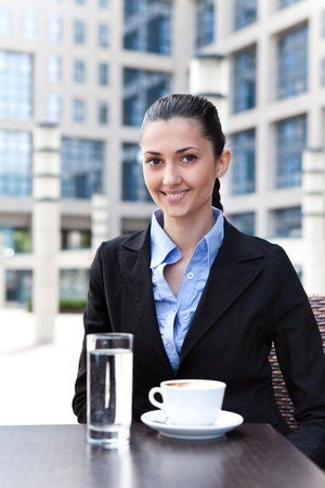 businesswoman having break,  outdoor drinking coffee photo