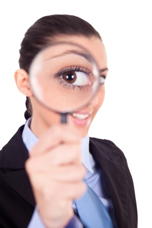 magnifying glass: close-up, smiling businesswoman looking through magnifying glass Stock Photo
