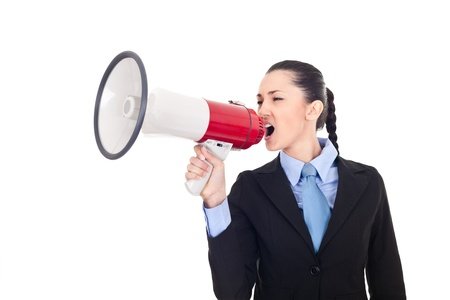 angry young businesswoman shouting into megaphone against white background  Stock Photo - 9653359